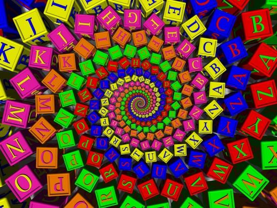 swirl of brightly coloured alphabet blocks