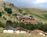 Isandlwana Lodge in the background with Zulu huts
