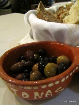 black and green olives in a terracotta bowl